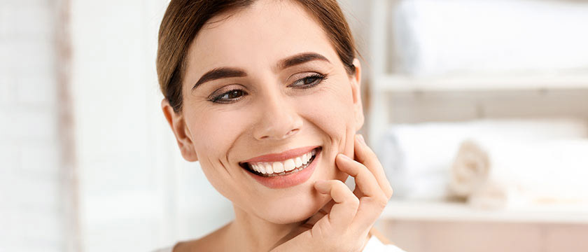 Dental Bridge vs Implant for A Missing Tooth – What's Best?